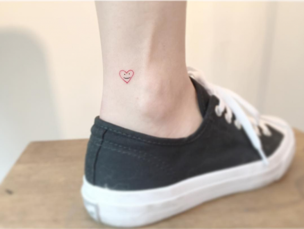 smiling heart tattoo