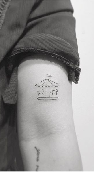 Minimalist Carousel Arm Tattoo