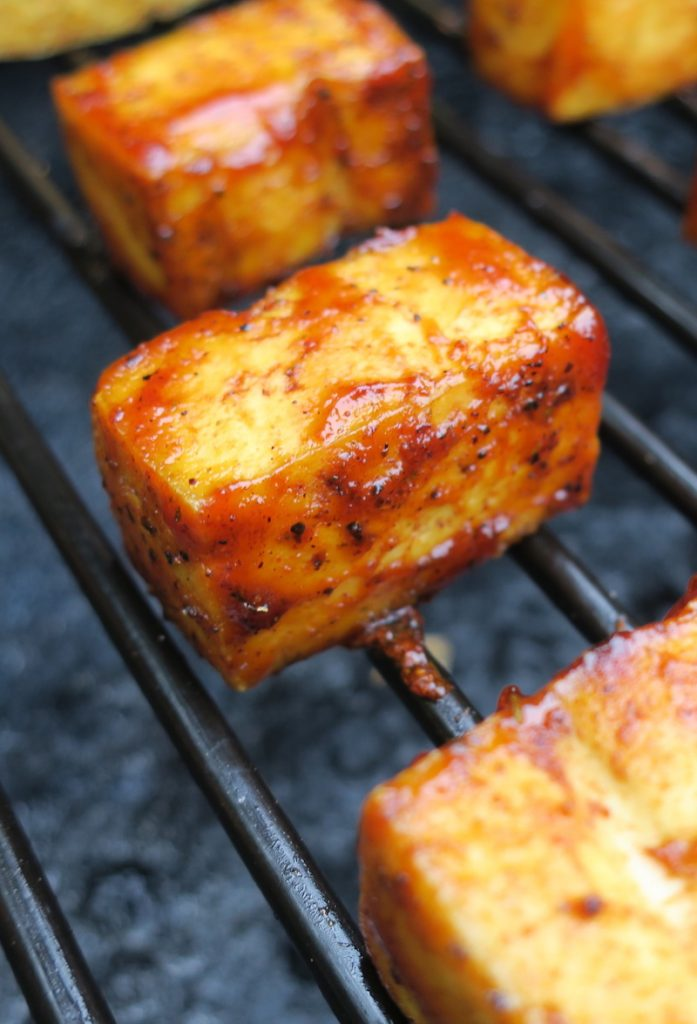 Vegan BBQ - smoked tofu on grill