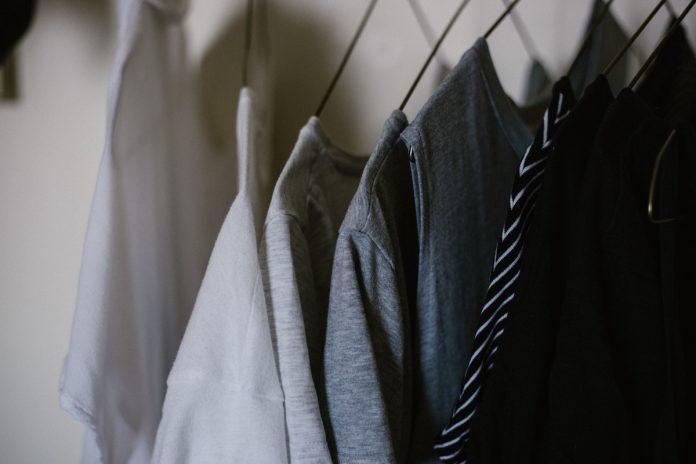 organized clothes hanging in closet