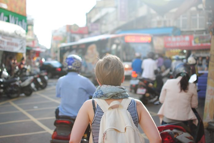 woman traveling solo in streets