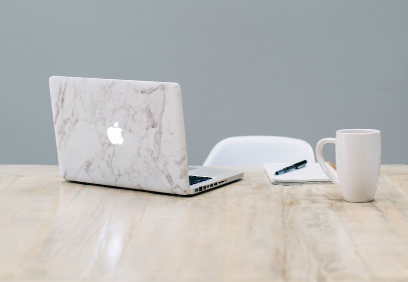 marble skin macbook on table
