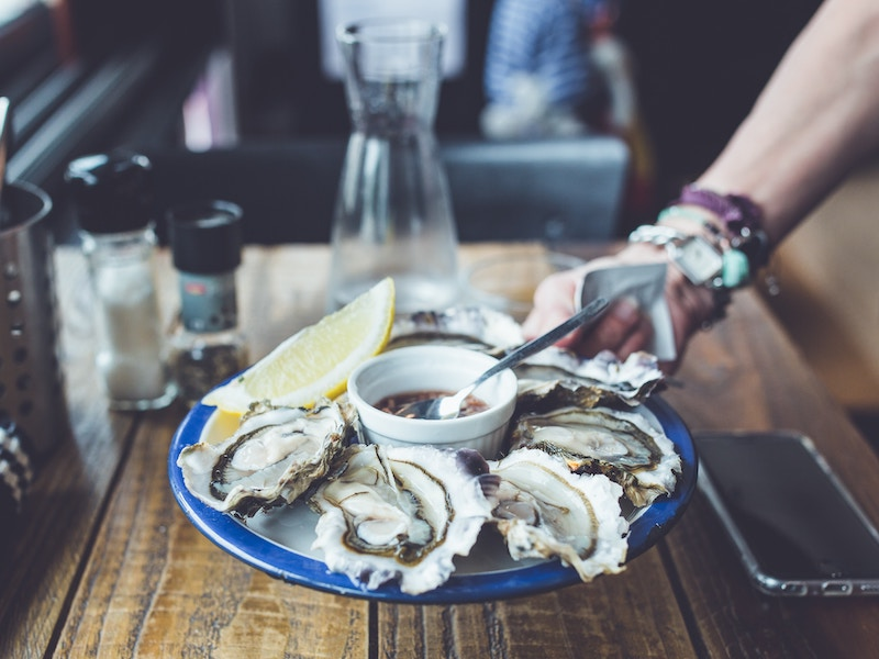 person serving oysters