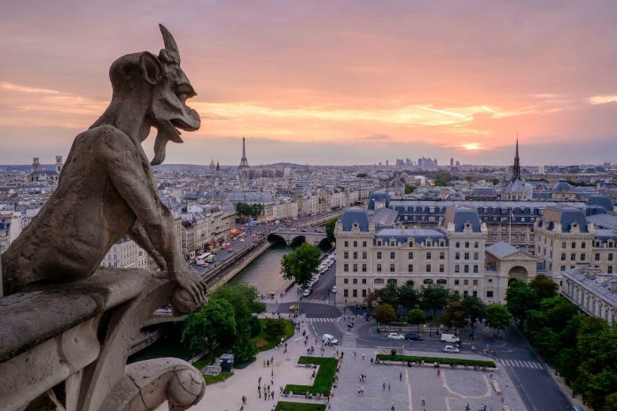 gargoyle overlooking Paris instagram spot